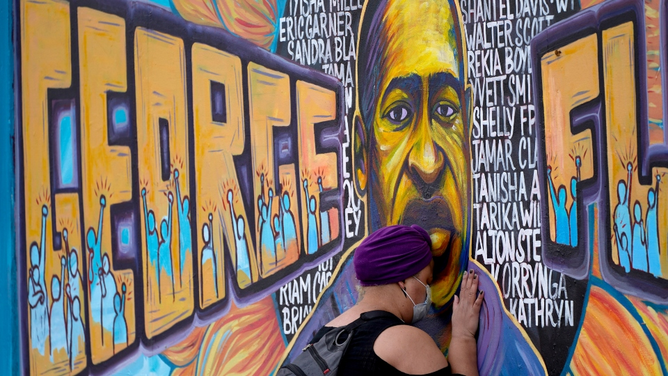 Damarra Atkins paid her respects to George Floyd at a mural at George Floyd Square, Friday, April 23, 2021, in Minneapolis.