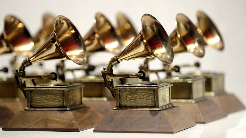 In this Oct. 10, 2017, file photo, various Grammy Awards are displayed at the Grammy Museum Experience at Prudential Center in Newark, N.J.