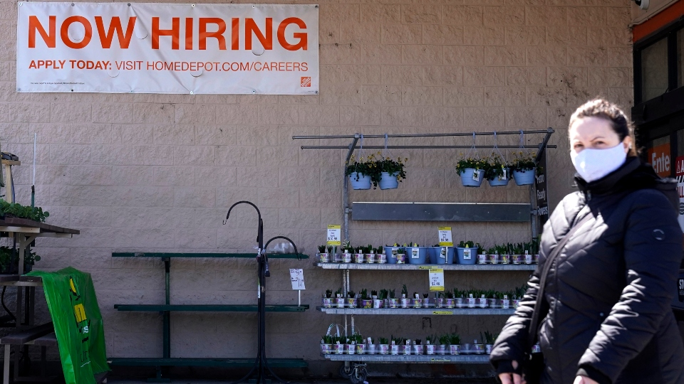 A hiring sign is seen outside home improvement store in Mount Prospect, Ill., Friday, April 2, 2021.