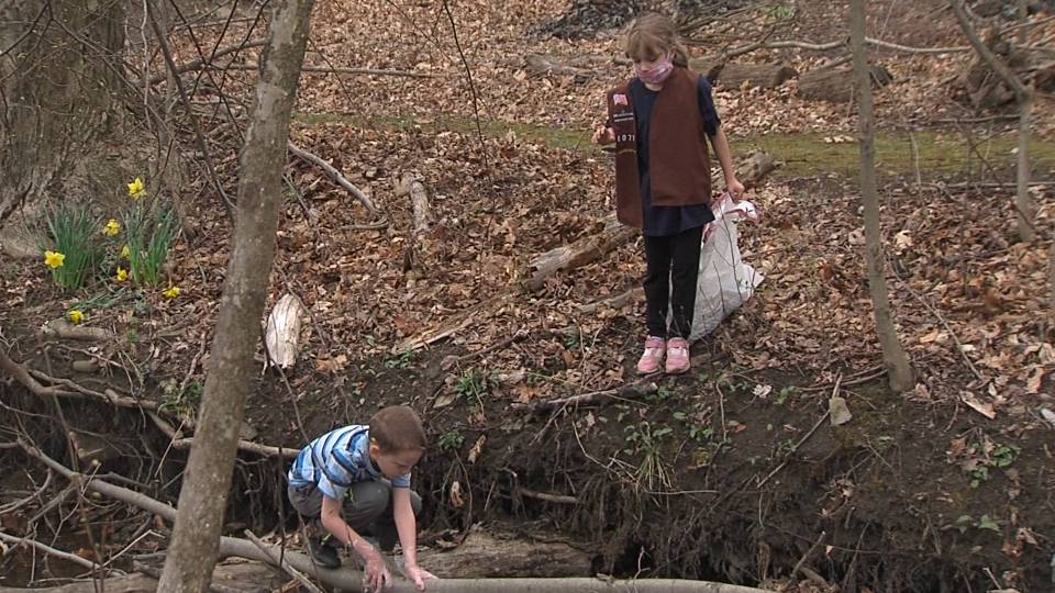 Cub scouts and girl scouts got together to help clean up Tod Park