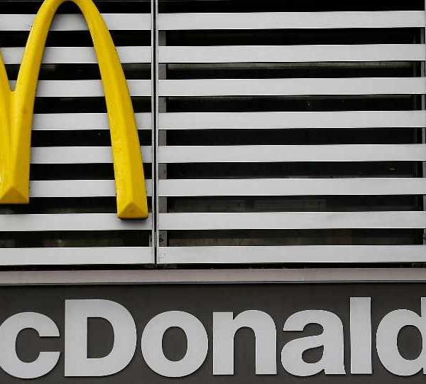 This Monday, April 24, 2017, photo shows a McDonald's sign and logo at a restaurant in downtown Pittsburgh. McDonald's says it's using fresh beef in another burger, the latest test by the chain swap out frozen beef as it seeks to improve the image of its food. The company says the new burger, called Archburger, is being tested in seven McDonald's restaurants in Tulsa, Okla.
