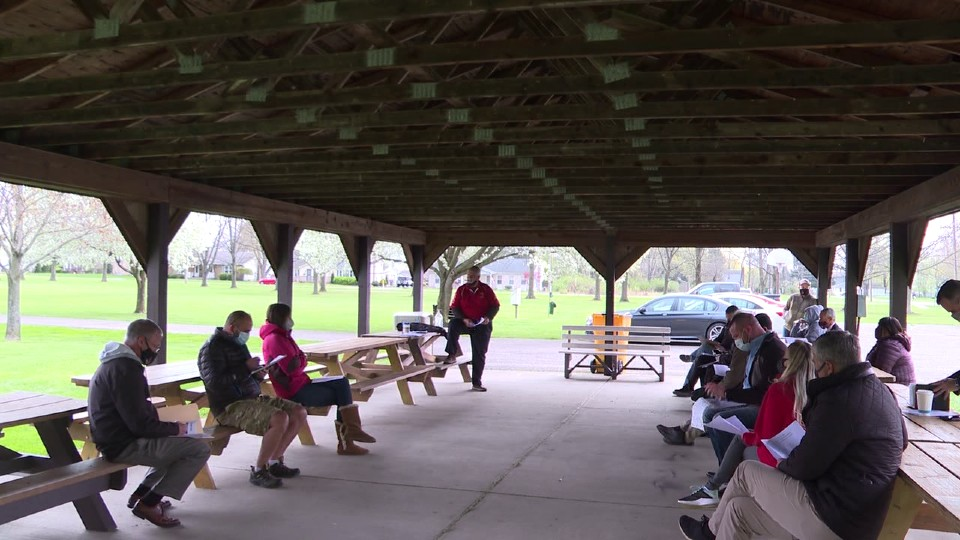 Meeting for annual charitable golf outing in Canfield