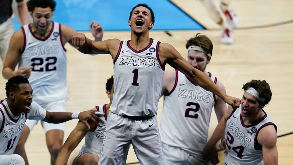 Gonzaga guard Jalen Suggs (1) celebrates making the game winning basket against UCLA during overtime in a men's Final Four NCAA college basketball tournament semifinal game, Saturday, April 3, 2021, at Lucas Oil Stadium in Indianapolis. Gonzaga won 93-90.