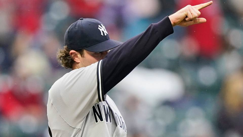 New York Yankees starting pitcher Gerrit Cole points to the outfield after Cleveland Indians' Jose Ramirez hit a triple in the fourth inning of a baseball game, Saturday, April 24, 2021, in Cleveland.