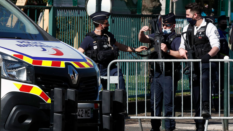 Police officers block the access with barriers next to the Police station in Rambouillet, south west of Paris