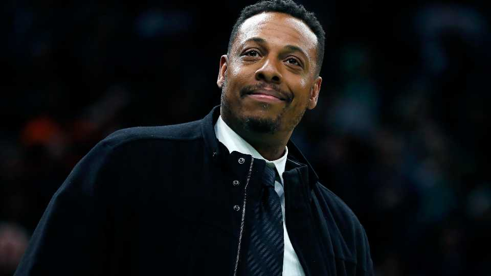 """FILE - Former Boston Celtic Paul Pierce attends the NBA basketball game between the Celtics and the Houston Rockets in Boston, Saturday, Feb. 29, 2020. Celtics star Paul Pierce, """"Showtime"""" Los Angeles Lakers star Michael Cooper and 11-time NBA All-Star Chris Bosh lead a list of 14 finalists for the Naismith Memorial Basketball Hall of Fame Class of 2021, Tuesday. March 9, 2021."""