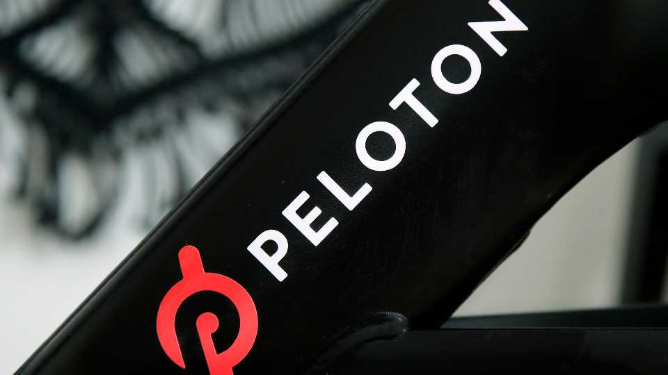 FILE - This Nov. 19, 2019 file photo shows a Peloton logo on the company's stationary bicycle in San Francisco. Safety regulators are warning people with kids and pets to immediately stop using a treadmill made by Peloton after one child died and nearly 40 others were injured. The U.S. Consumer Product Safety Commission said Saturday, April 17, 2021, that it received reports of children and a pet being pulled, pinned and entrapped under the rear roller of the treadmill, leading to fractures, scrapes and the death of one child.