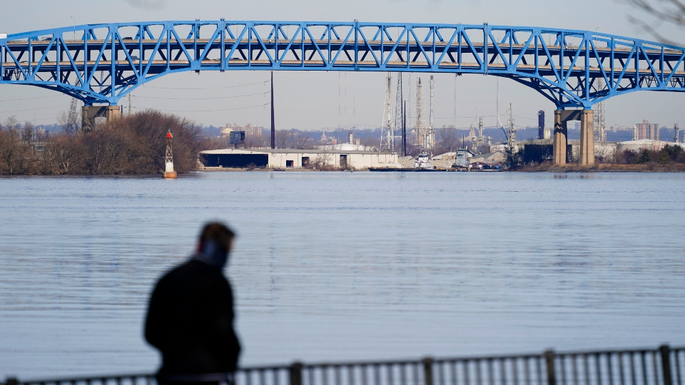 In this Wednesday, Feb. 24, 2021, file photo, person walks past the Interstate-95′s mile-long double-decked Girard Point Bridge in Philadelphia.