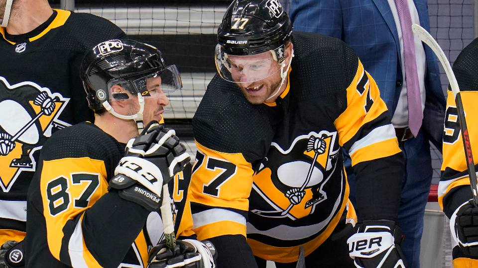 Pittsburgh Penguins' Sidney Crosby (87) and Jeff Carter (77) celebrate after Carter scored during the first period of an NHL hockey game in Pittsburgh, Saturday, April 24, 2021. The Penguins won 4-2.