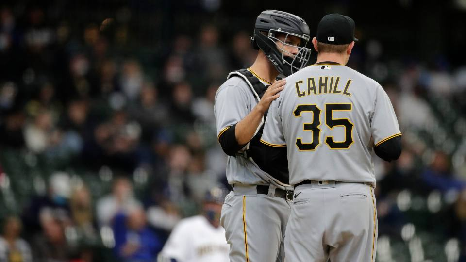 Pittsburgh Pirates' Trevor Cahill (35) talks with Jacob Stallings during the first inning of a baseball game against the Milwaukee Brewers, Saturday, April 17, 2021, in Milwaukee.
