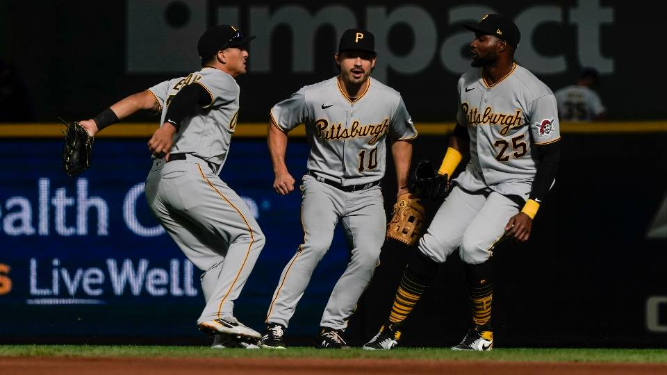 Pittsburgh Pirates' Phillip Evans, Bryan Reynolds and Gregory Polanco celebrate after the 10th inning of a baseball game against the Milwaukee Brewers Sunday, April 18, 2021, in Milwaukee. The Pirates won 6-5.