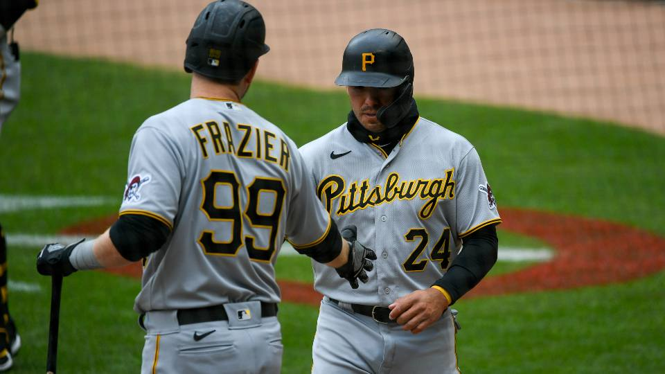 Pittsburgh Pirates' Phillip Evans, right, celebrates with designated hitter Todd Frazier after scoring on a hit by teammate Colin Moran against the Minnesota Twins during the first inning of a baseball game, Sunday, April 25, 2021, in Minneapolis.