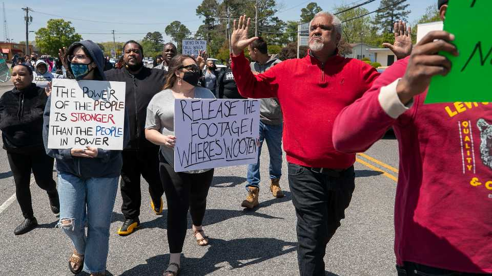 Kirk Rivers leads a group of demonstrators as they block Ehringhaus Street, a main retail avenue in Elizabeth City, N.C., Friday, April 23, 2021, as they demand after a fatal shooting that body camera video be released by the Pasquotank Sheriff's office. Andrew Brown Jr., a 42-year-old Black man from Elizabeth City, N.C., was shot to death Wednesday by one or more deputy sheriffs trying to serve drug-related search and arrest warrants.