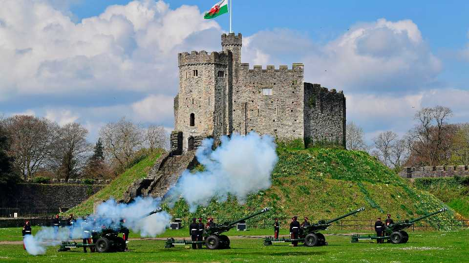 Members of the 104th Regiment Royal Artillery fire a 41-round gun salute in the grounds of Cardiff Castle, to mark the death of Prince Philip, in Cardiff, Saturday, April 10, 2021. Britain's Prince Philip, the irascible and tough-minded husband of Queen Elizabeth II who spent more than seven decades supporting his wife in a role that mostly defined his life, died on Friday.