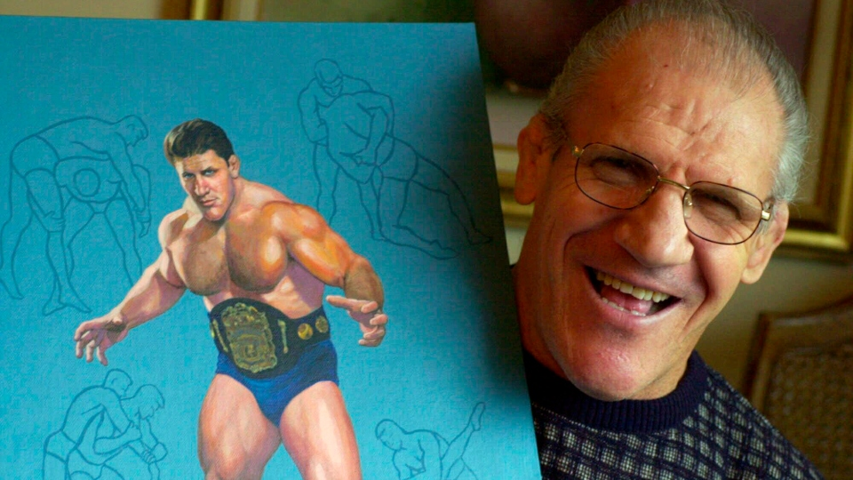 In this Nov. 30, 2000, file photo, former pro wrestler Bruno Sammartino poses with a painting of him in his Pittsburgh home. A Pittsburgh suburb on Friday, April 23, 2021 honored Sammartino by renaming a park in the longtime resident's honor.