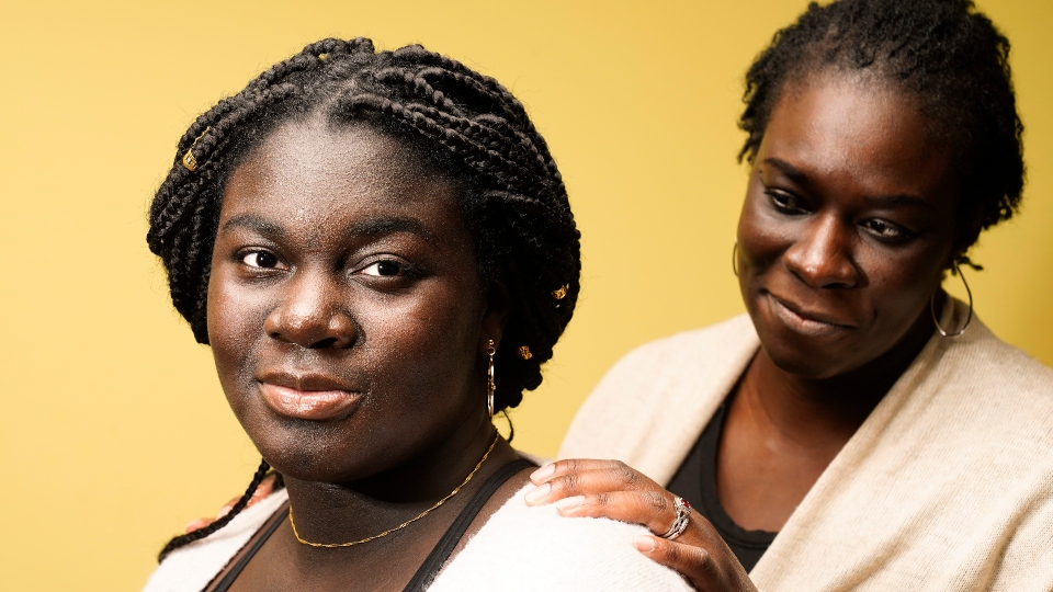 Ebele Azikiwe, 12, poses for a photo with her mother, Rume Joy Azikiwe-Oyeyemi, in Cherry Hill, N.J., Wednesday, March 24, 2021.