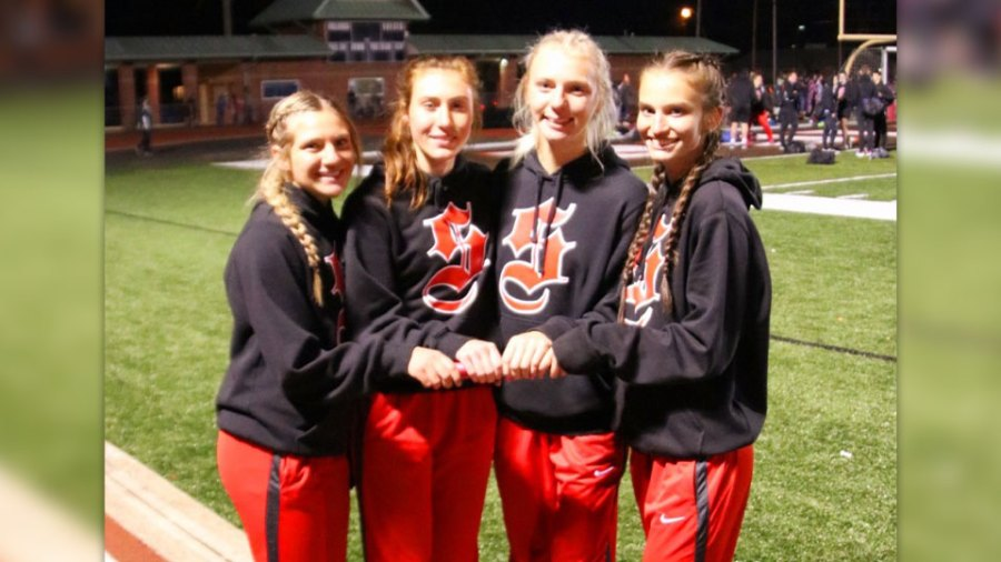 4 by 4 team that broke the meet record: Rylee Hutton, Carly Hall, Ella Double and Halle Cochran