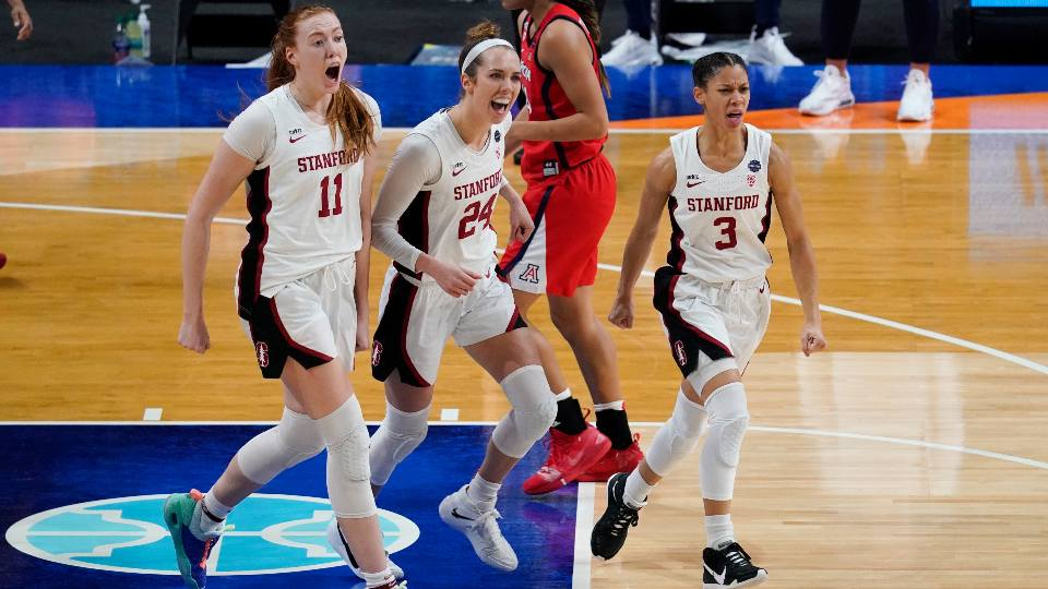 Stanford forward Ashten Prechtel (11), guard Lacie Hull (24) and guard Anna Wilson (3) celebrate during the first half of the championship game against Arizona in the women's Final Four NCAA college basketball tournament, Sunday, April 4, 2021, at the Alamodome in San Antonio.