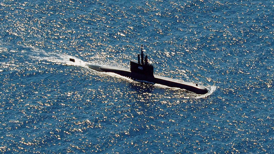 Indonesian Navy submarine KRI Alugoro sails during a search for KRI Nanggala, another submarine that went missing while participating in a training exercise on Wednesday, in the waters off Bali Island, Indonesia, Thursday, April 22, 2021