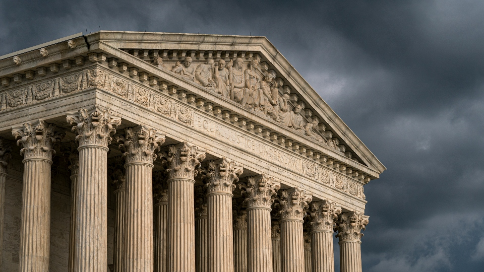 In this June 20, 2019, file photo, the Supreme Court is seen in Washington as a storm rolls in.