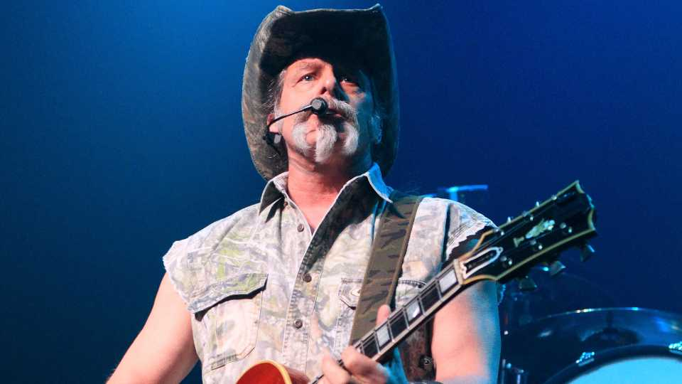"FILE - Ted Nugent performs at Rams Head Live in Baltimore on Aug. 16, 2013. Nugent revealed he was in agony after testing positive for coronavirus — months after he said the virus was ""not a real pandemic."" ""I thought I was dying,"" Nugent says in a Facebook live video posted Monday. (Photo by Owen Sweeney/Invision/AP, File)"