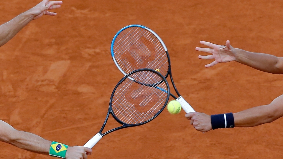In this file photo dated Saturday, Oct. 10, 2020, Croatia's Mate Pavic, right, and Brazil's Bruno Soares play a shot in the men's doubles final match of the French Open tennis tournament at the Roland Garros stadium in Paris, France.