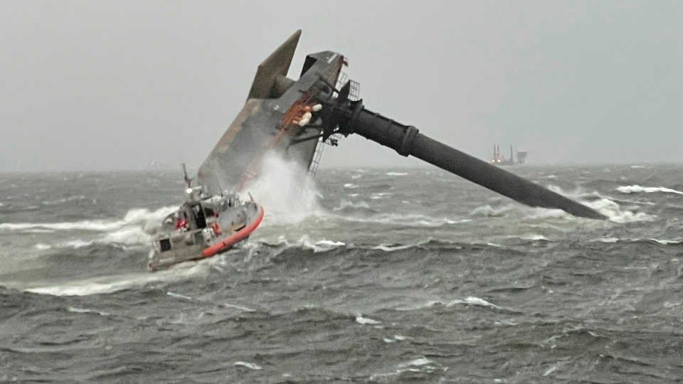 A Coast Guard Station Grand Isle 45-foot Respone Boat-Medium boatcrew heads toward a capsized 175-foot commercial lift boat Tuesday, April 13, 2021, searching for people in the water 8 miles south of Grand Isle, Louisiana.