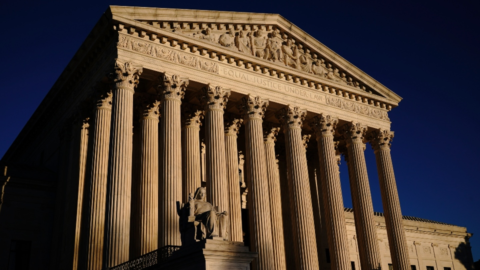 In this Nov. 2, 2020, file photo the Supreme Court is seen at sundown in Washington.