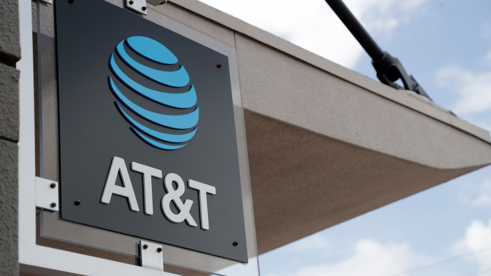 In this July 18, 2019, file photo, a sign is displayed at an AT&T retail store in Miami.