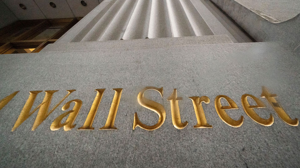 Wall Street is carved in the side of a building