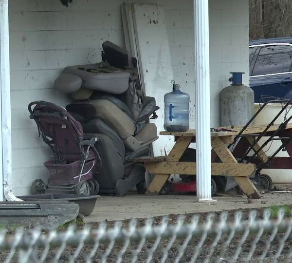 A Warren man is accused of running an auto body business out of his house.