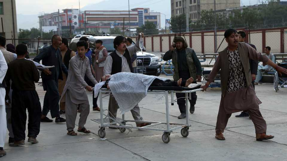 An injured school student is transported to a hospital after a bomb explosion near a school in west of Kabul, Afghanistan, Saturday, May 8, 2021. A bomb exploded near a school in west Kabul on Saturday, killing several people, many them young students, an Afghan government spokesmen said.