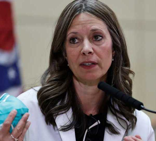 FILE - In this Feb. 27, 2020 file photo, Ohio Department of Health Director Dr. Amy Acton gives an update on the state's preparedness and education efforts to limit the spread of COVID-19, in Cleveland. Acton and six other people who risked their own health and safety to help and protect others during the coronavirus pandemic will receive special Profile in Courage awards next month, the John F. Kennedy Library Foundation announced Tuesday, May 4, 2021.