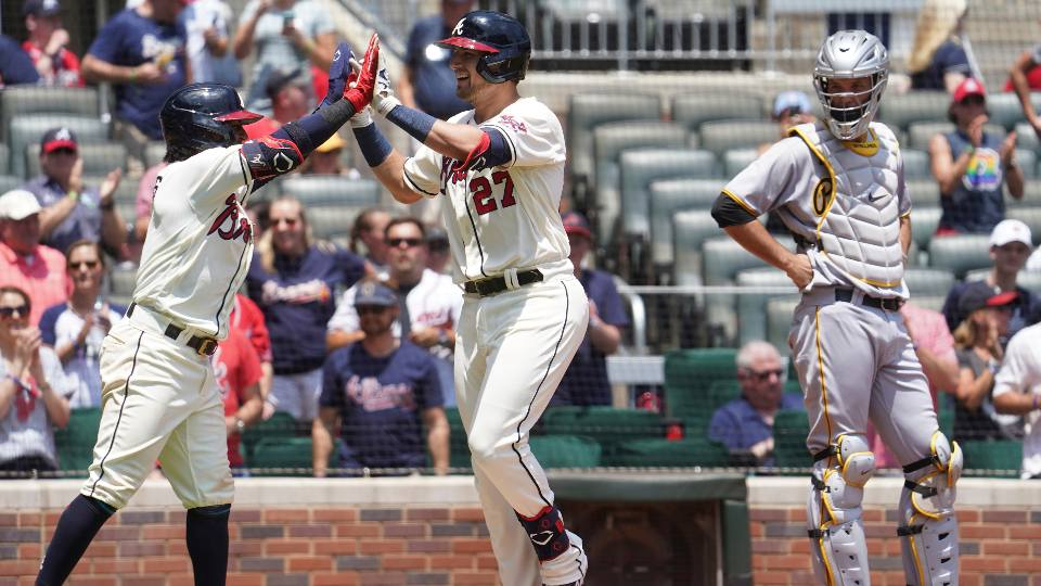 Atlanta Braves Austin Riley, center, celebrates with teammate Ozzie Albies,left, after two-run home run as Pittsburgh Pirates catcher Jacob Stallings watches in the third inning of a baseball game Sunday, May 23, 2021 in Atlanta.