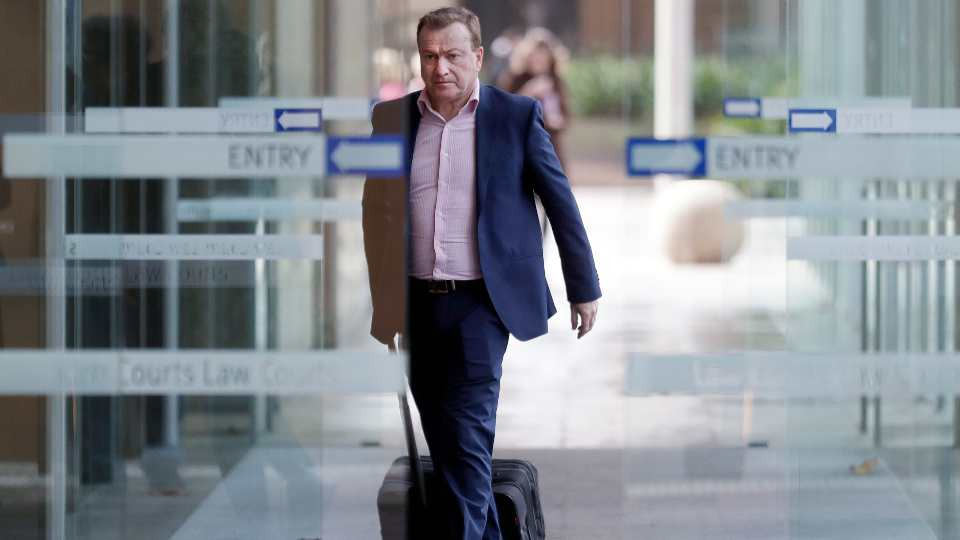 In this May 6, 2021, file photo, Andrew Cooper, founder and president of libertarian group LibertyWorks, arrives at Federal Court in Sydney. An Australian court on Tuesday, June 1, 2021, has rejected a challenge to the federal government's draconian power to prevent most citizens from leaving the country so that they don't bring COVID-19 home.