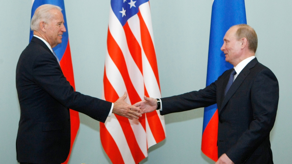 In this March 10, 2011, file photo, then Vice President Joe Biden, left, shakes hands with Russian Prime Minister Vladimir Putin in Moscow, Russia.