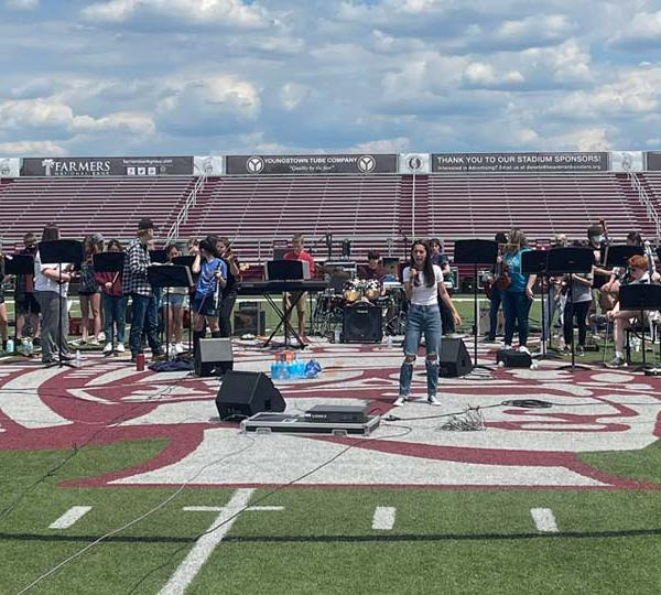 Students and staff at Boardman High School prepare for the Mayhem Concert.