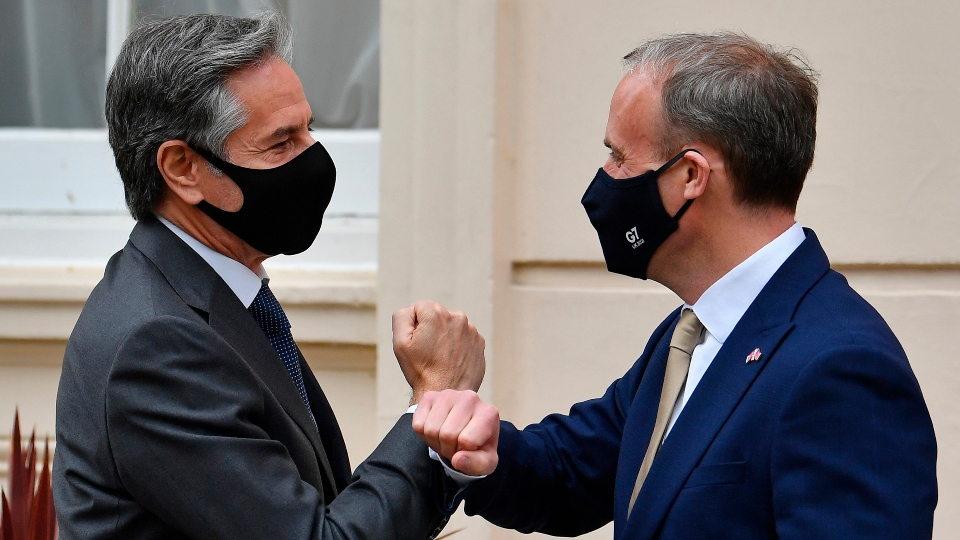 Britain's Foreign Secretary Dominic Raab, right, welcomes U.S. Secretary of State Antony Blinken ahead of bilateral talks as part of the G7 foreign ministers meeting near London, Monday May 3, 2021.