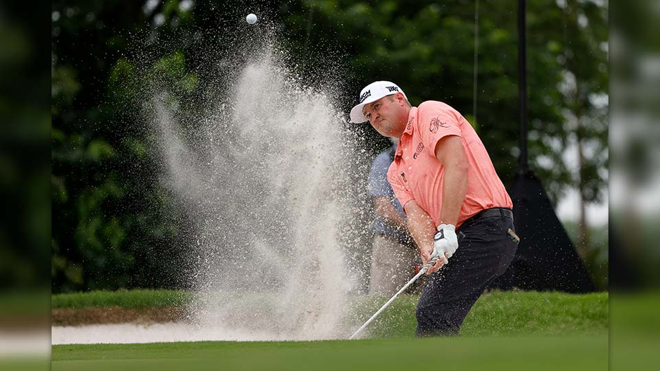 Jason Kokrak hits out of a bunker on the seventh green during the final round of the Charles Schwab Challenge golf tournament at Colonial Country Club in Fort Worth, Texas, Sunday, May 30, 2021.