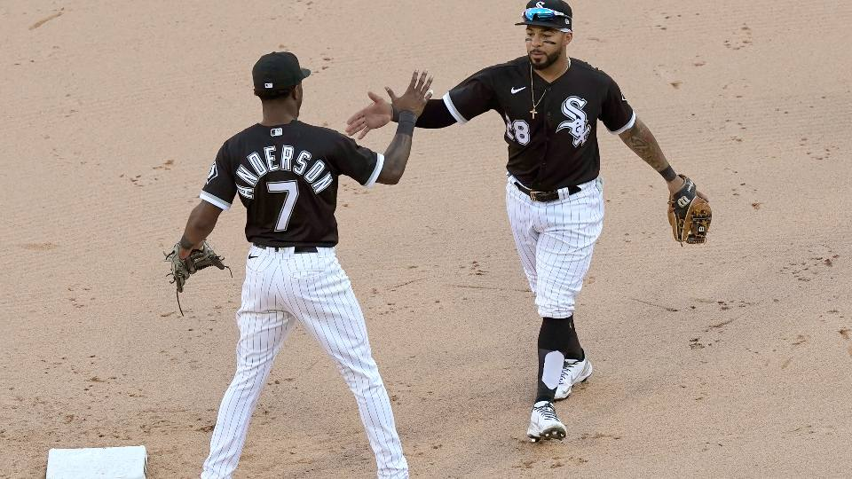 Chicago White Sox's Tim Anderson (7) and Leury Garcia celebrate the team's 7-3 win over the Cleveland Indians in a baseball game Saturday, May 1, 2021, in Chicago. Anderson and Garcia accounted for all the White Sox runs.