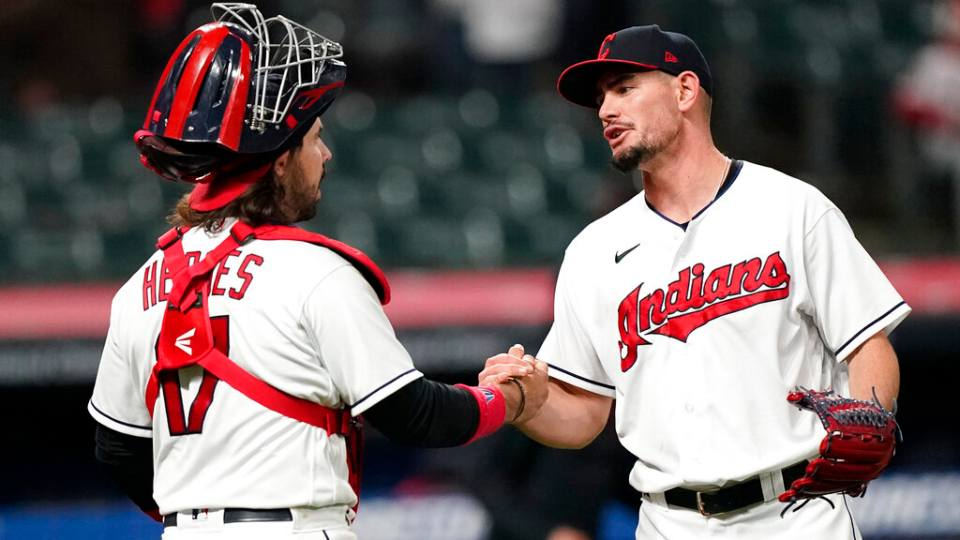 Cleveland Indians relief pitcher Nick Wittgren, right, is congratulated by catcher Austin Hedges after the Indians defeated the Cincinnati Reds 9-2 in a baseball game Saturday, May 8, 2021, in Cleveland.