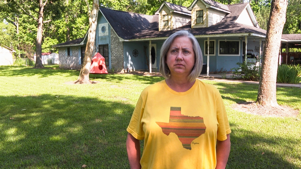 Laurie Fields, who lives in Forest Manor subdivision, speaks during an interview outside her Huffman, Texas home on May 10, 2021.
