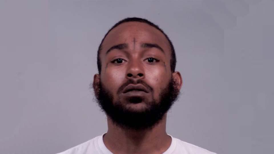 Damien Smart, charged with improperly handling firearm in motor vehicle in Warren.