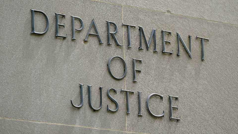 This May 4, 2021, photo shows a sign outside the Robert F. Kennedy Department of Justice building in Washington. The Trump Justice Department secretly seized the phone records of three Washington Post reporters who covered the federal investigation into ties between Russia and Donald Trump's campaign, the newspa