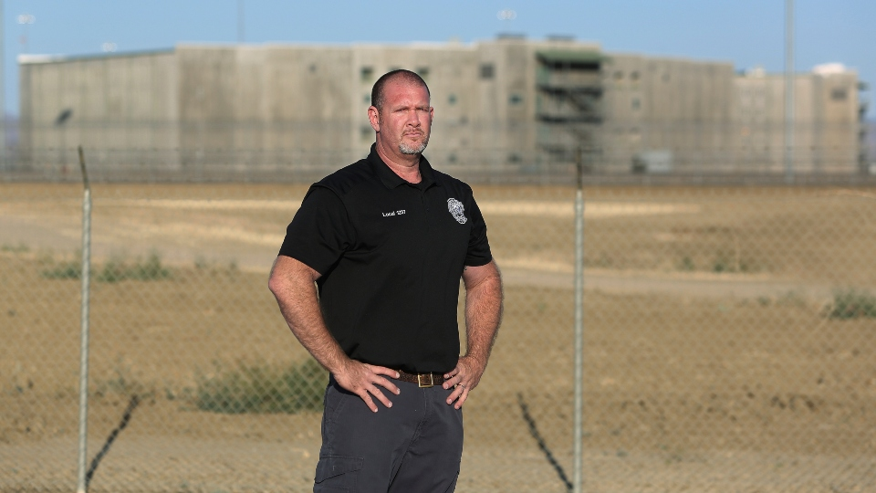 Aaron McGlothin, union president at the Federal Correctional Institution at Mendota, stands in front of the prison during a protest against staffing shortages, near the prison entrance in Mendota, Calif., Monday, May 17, 2021.