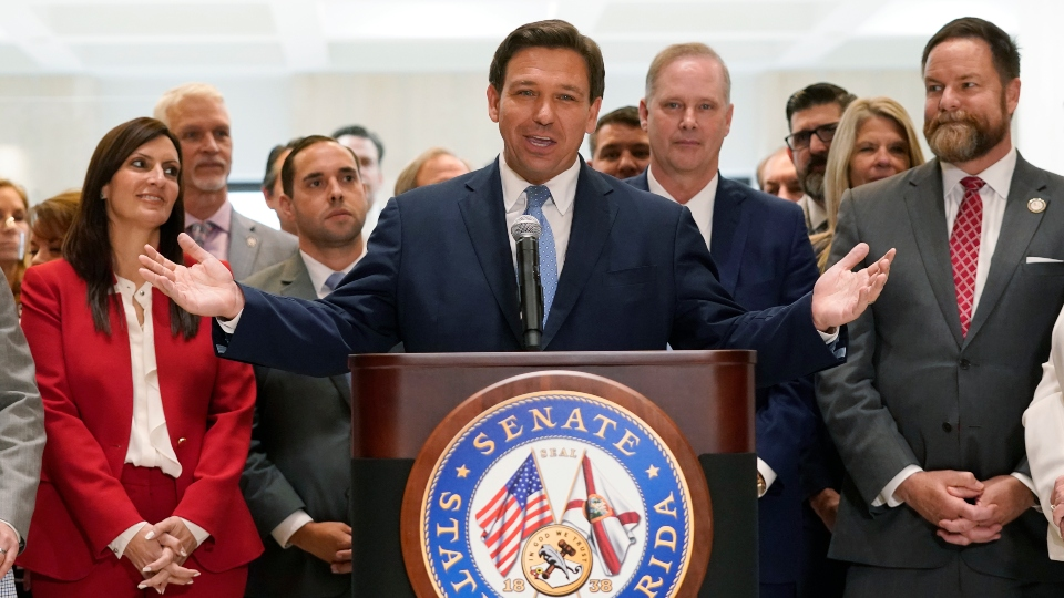 Surrounded by lawmakers, Florida Gov.Ron DeSantis speaks at the end of a legislative session, Friday, April 30, 2021, at the Capitol in Tallahassee, Fla.