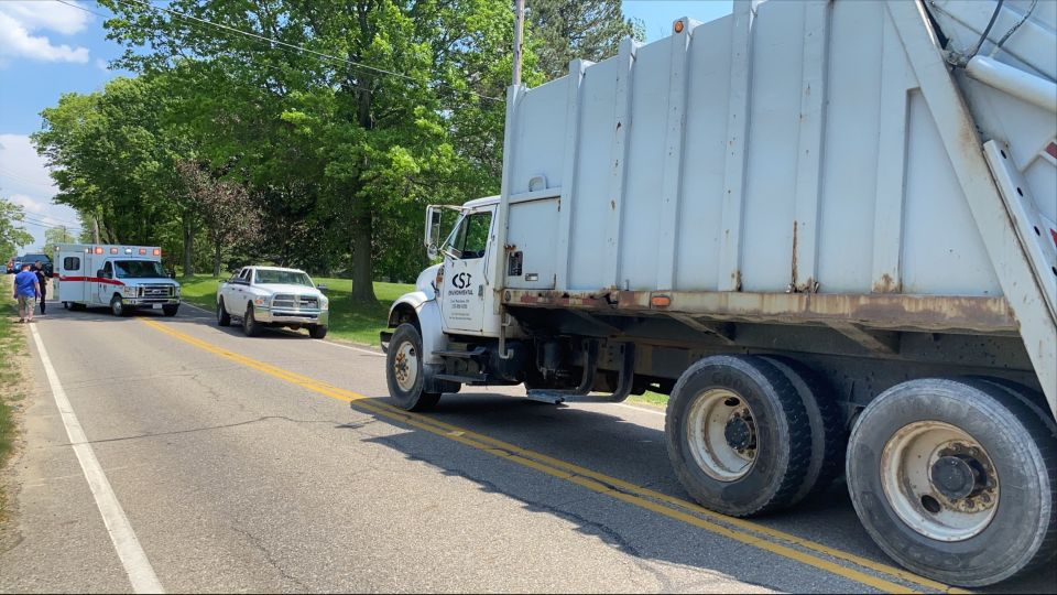 A garbage truck driver was hit in Columbiana