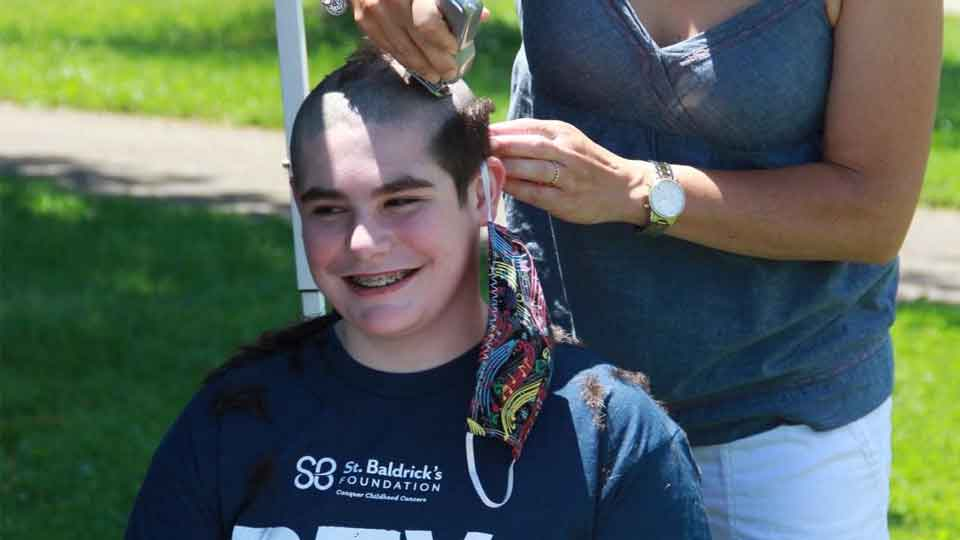 Gavin Clay gets his head shaved at the virtual St. Baldrick's event held at DJ's bench in June 2020. Clay was named the United Way of Greater Stark County's 2021 Inspired Youth Award Recipient. Photo Credit: West Branch Local School District