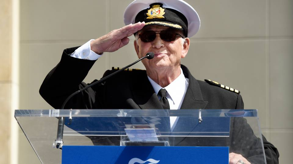"""In this May 10, 2018 file photo, Gavin MacLeod, a cast member on the TV series """"The Love Boat,"""" salutes the crowd as he speaks at a Friends of Hollywood Walk of Fame honorary star plaque ceremony for the cast and Princess Cruises in Los Angeles. Gavin MacLeod has died. His nephew told the trade paper Variety that MacLeod died early Saturday, May 29, 2021."""