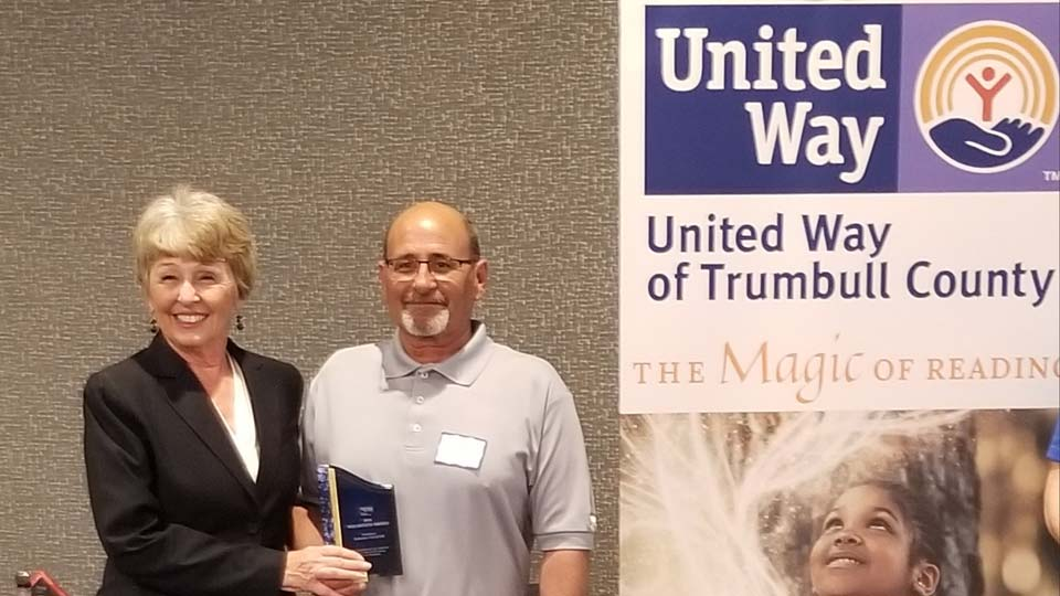 United Way of Trumbull County president Ginny Pasha (left) recognizes Jim Ledenko (right) for the Laborers' Local 935's work in Perkins Park at the annual luncheon Thursday, May 20. Credit: United Way of Trumbull County